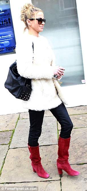 Sole-ful star: The singer strutted stylishly down the road with her boots being the centre of attention