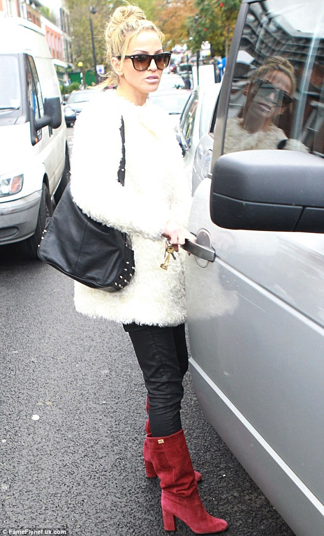 Lady in red: Sarah Harding was seen leaving a dentist on Wednesday afternoon, wearing a pair of red boots in Primrose Hill
