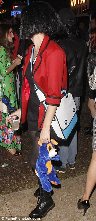 Well-equipped: Katy carried a drink and a teddy bear around the Hollywood Forever Cemetery