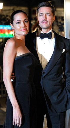 Angelina Jolie and Brad Pitt at the premiere of The Curious Case of Benjamin Button where Angelina wore a stunning L'Wren Scott dress