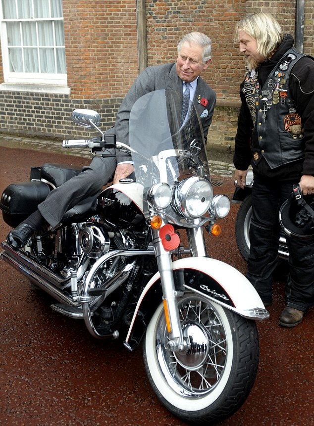 Try this on for size: The Prince of Wales hops on the impressive bike during his meeting to promote London Poppy Day