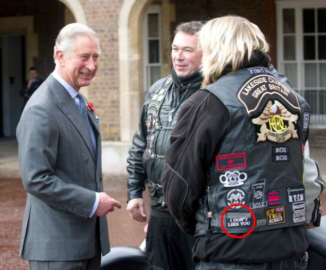 Subtle: The man had the message - highlighted above with expletive obscured by MailOnline - sewn into the back of his waistcoat and it appeared Prince Charles didn't notice
