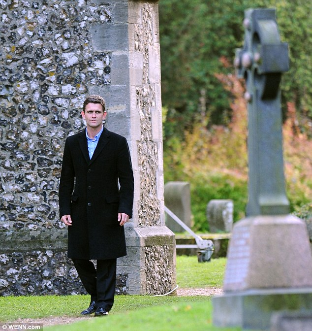 For whom the bell tolls: Jack Branning, played by Scott Maslen, walks through a churchyard while filming scenes for EastEnders ahead of Derek Branning's death