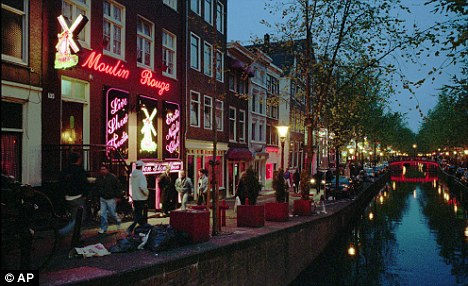 Red light district: Brothels and 'coffee shops' line the streets in parts of Amsterdam