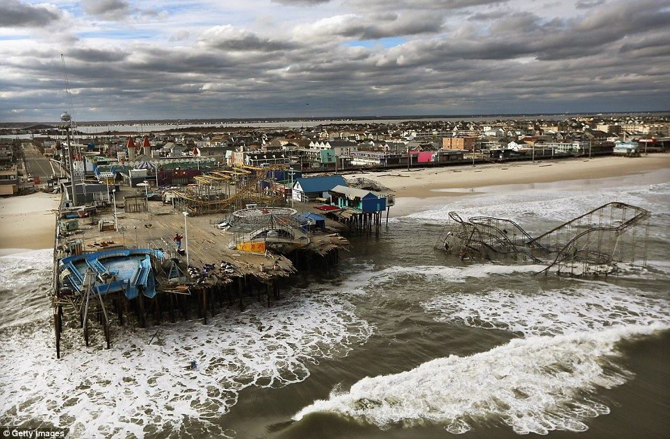 Awful: Waves break in front of the destroyed amusement park