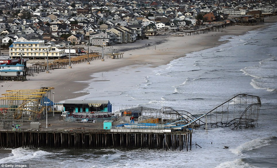 Destroyed: Besides ravaging beaches, the behemoth of a storm swept entire neighborhoods away, wrecked boardwalks and knocked amusement park rides from piers, including the famous Seaside Heights roller coaster