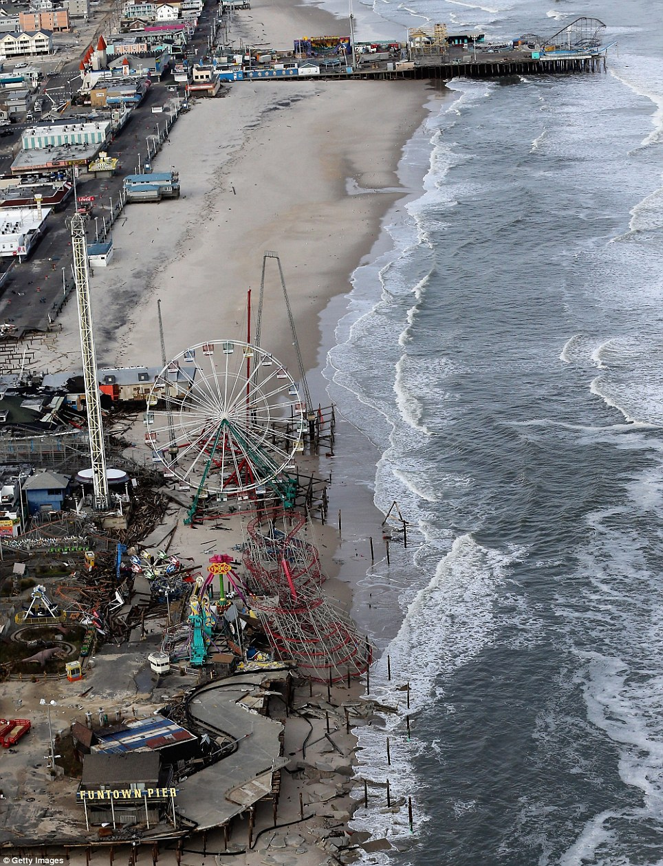 Tragic: At least 50 people were reportedly killed in the U.S. by Sandy with New Jersey suffering massive damage and power outages. This picture shows the length of the popular beach at Seaside Heights