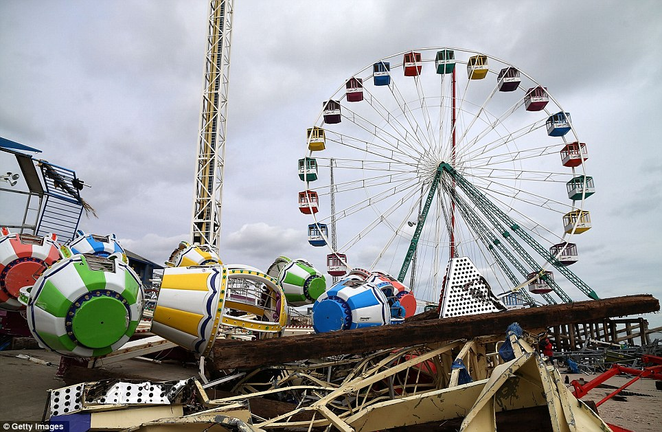Chaotic: Amusement rides lie mangled after the Fun Town pier they sat on was destroyed by Superstorm Sandy