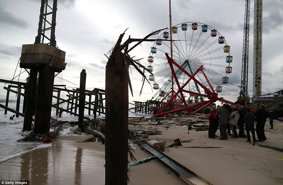 Mess: The famous Seaside Heights roller coaster on the fun time pier is now a twisted mass of metal in the ocean. A 100-year-old merry-go round was also destroyed