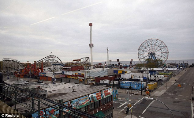 Before the storm: Amusement park rides are seen out a window of a subway train before the arrival of Hurricane Sandy at Coney Island