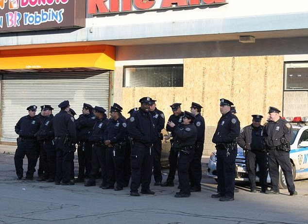 Police station destroyed: Cops were stationed outside of a Rite Aid after the 60th Precinct's station house flooded
