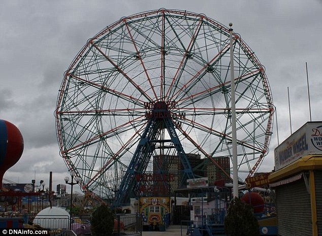 The aftermath: The Wonder Wheel after Hurricane Sandy still stands in Coney Island amidst the destruction