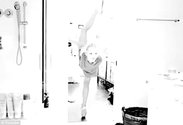 Prima ballerina: Ashlee also displays her flexibility in the clip, showing off some of her ballet moves in the bathroom