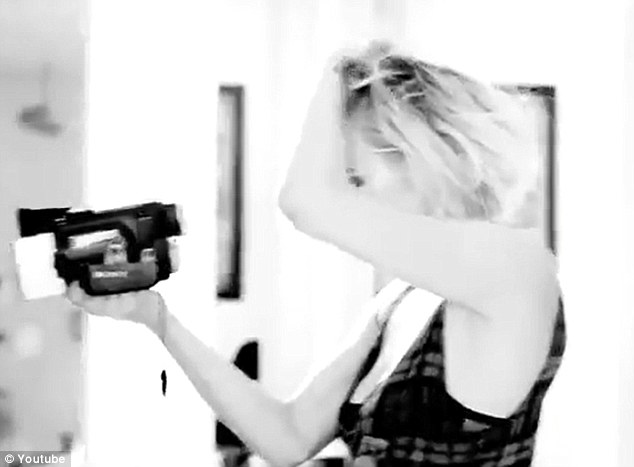 Self shot: Ashlee at times is filming herself with a handheld video camera