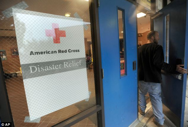 A man enters a Red Cross shelter at Annapolis High School in Annapolis, Maryland, to donate before the hurricane hit