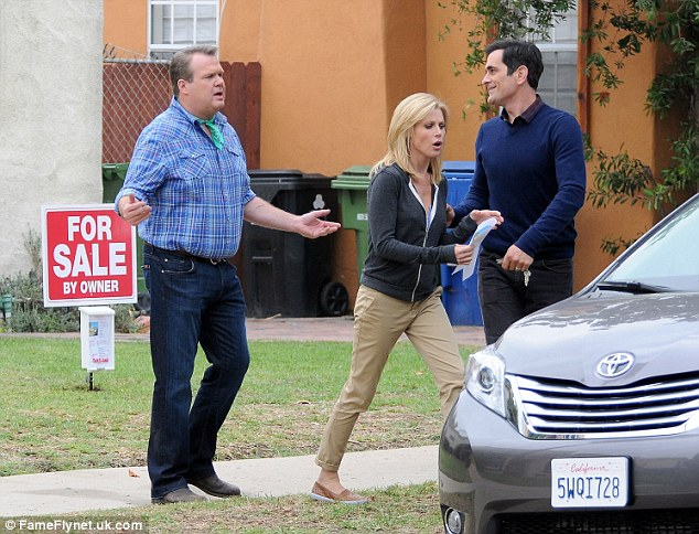 So funny: Julie seems to be caught between her co-stars Eric and Ty Burrell