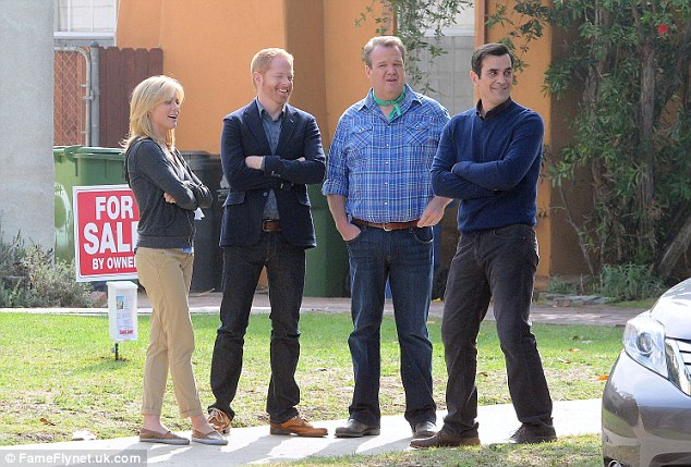 Buying a house? The cast of characters stand in front of a home that's for sale