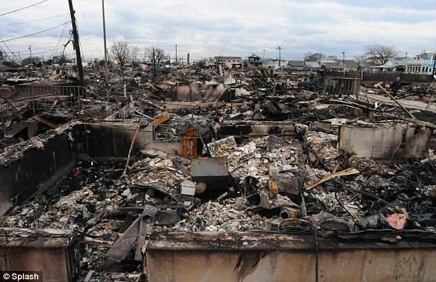 More than 100 homes were destroyed in Breezy Point, Queens. Flatbed trucks that originally helped with rescue operations had been diverted to prepare for the marathon, which is now canceled