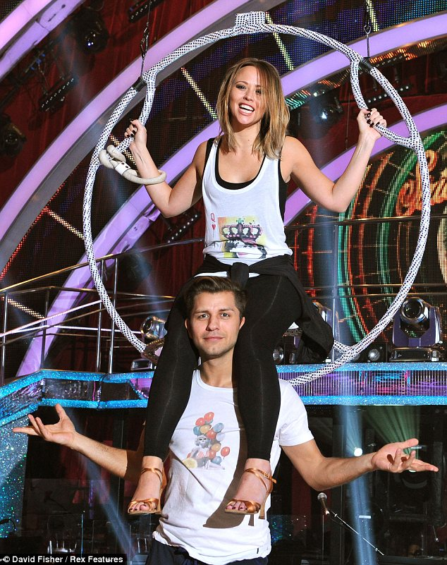 Lofty position: Kimberley Walsh was seen practicing her routine with partner Pasha Kovalev while sat in a suspended hoop