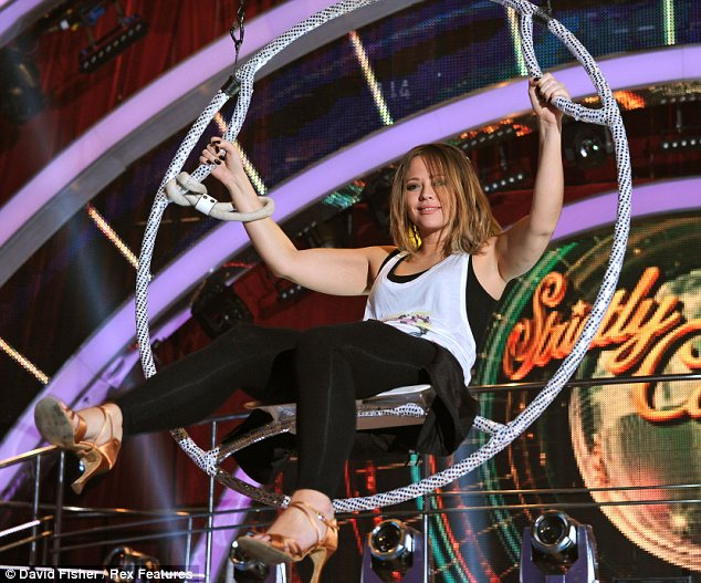 Laid back lady: Kimberley seemed more than comfortable sat in her suspended hoop