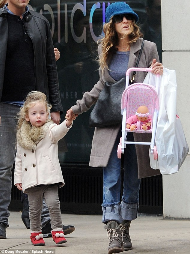 Bored now: Sarah Jessica carried little Marion's stroller after lunch on Madison Avenue in Manhattan