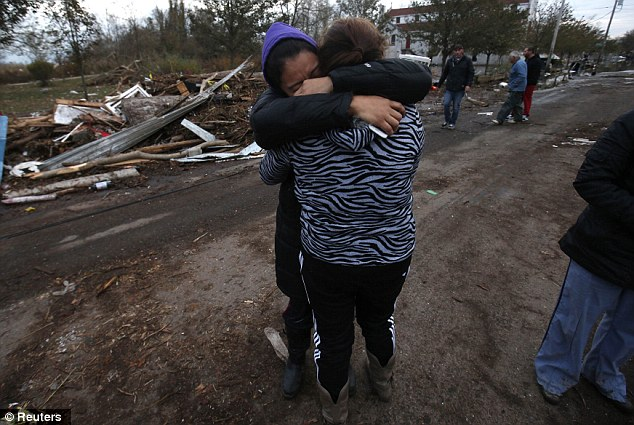 Devastation: Dulce Espino (left) and Viridiana Cruz weep in their Staten Island neighborhood where many houses were completely destroyed