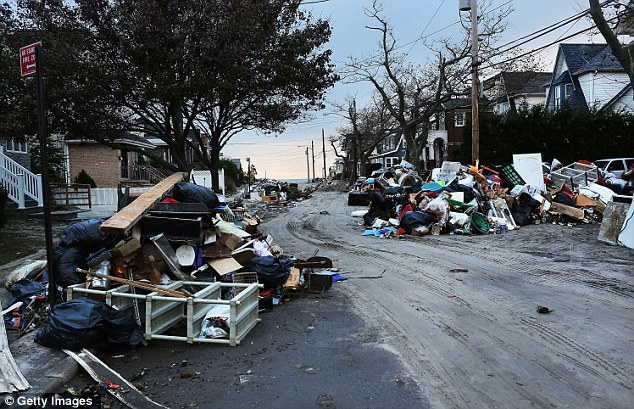 Mounds of debris pile up in the street in the heavily damaged Rockaway neighborhood