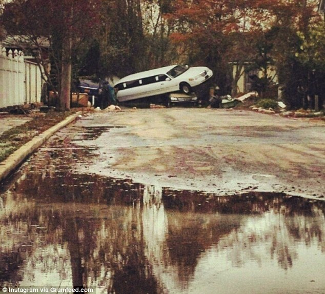 Aftermath: A limousine sits atop another vehicle in South Beach on Staten Island