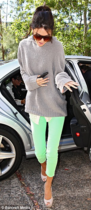 Hiding her eyes: The youngest of the famous family appeared nervous and kept her head down as she made her way into the studio followed by mum Kris who wore trendy Converseest of the famous family appeared nervous and kept her head down