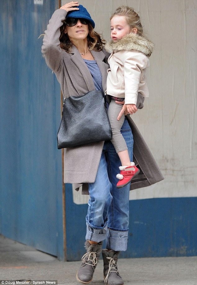 Low key: Sarah Jessica went without make-up and sported a casual pair of jeans, dark grey coat and knitted blue hat