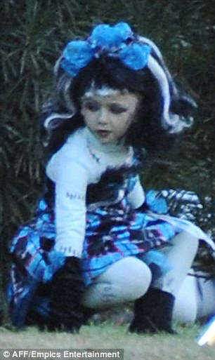 Pink pirate! The precocious seven-year-old was seen playing in her McIntyre home's front yard alongside a similarly costumed friend on Wednesday