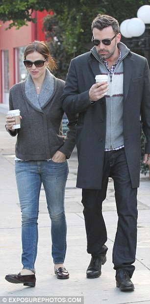 Still loved up: The down-to-earth Hollywood couple look deep in conversation during their trip out