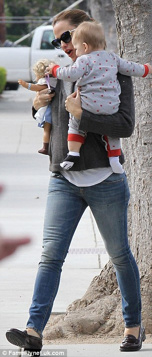 Dressed down mum: Jennifer opts for her usual casual style, wearing blue jeans and a grey fleece