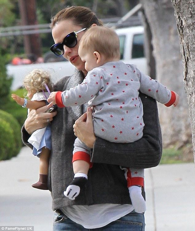 Supermum: Jennifer Garner takes son Samuel and a toy doll on a stroll through Brentwood, California