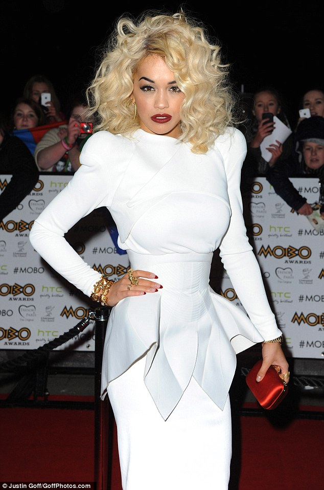 A vision in white: Rita's dress showed off her small waist and slim figure