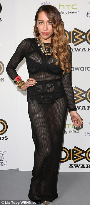 Baring it all: Singer Delilah sizzled in a see-through black dress that revealed her best assets