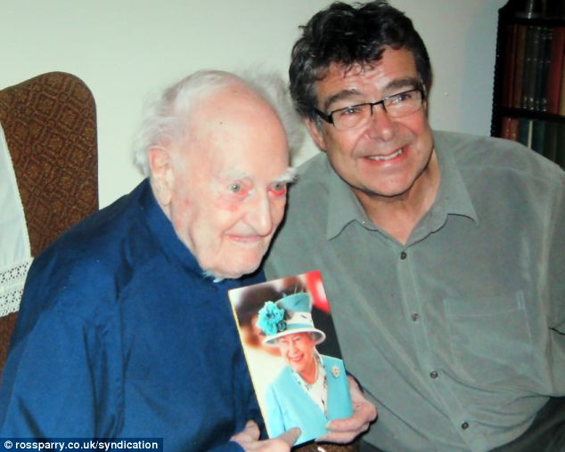 Honour: Rev. Dean and his son Christopher with his birthday card from the Queen when he became a centenarian in 2002