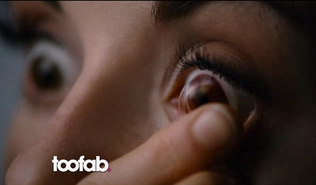 Eye eye: Bella's character puts in a pair of contact lenses during a scene in Breaking Dawn: Part II
