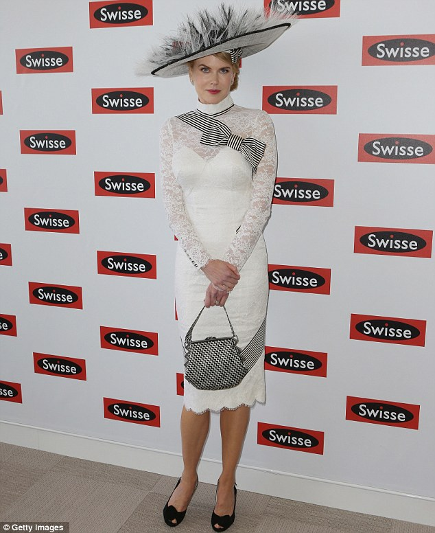 A-list attendee: Nicole Kidman looked exquisite in a white-lace My Fair Lady-inspired outfit designed by her good chum L'Wren Scott and was complemented by a stunningly spectacular hat renowned milliner Stephen Jones