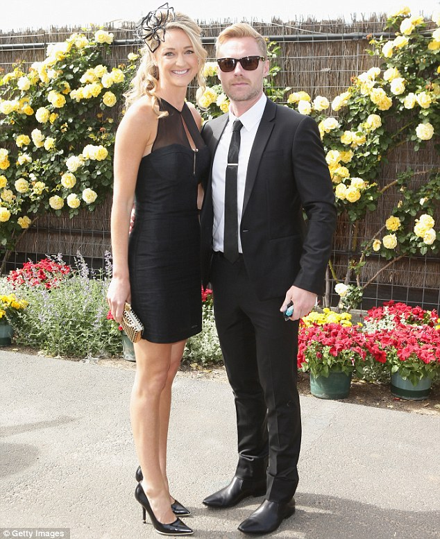 Matching monochrome: Ronan Keating and his girlfriend Storm Uechtritz cut a stylish duo as they attended Derby Day at Melbourne's Flemington Racecourse on Saturday afternoon