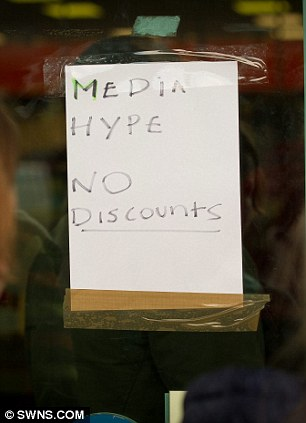 Signs inform people that there are no discounts