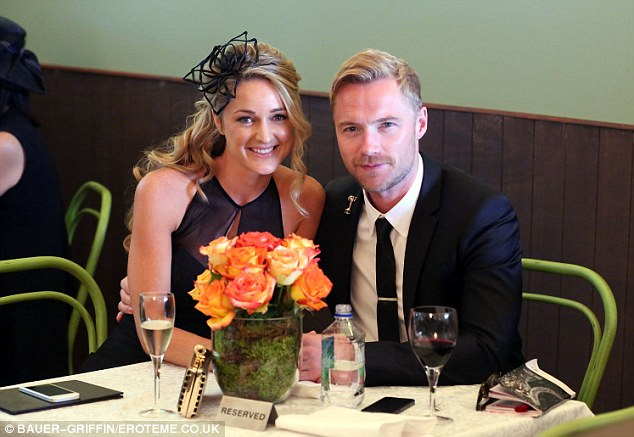 Picture perfect: Ronan and Storm looked like the smitten couple as they posed for a picture together in their dapper get-ups for the Derby Day