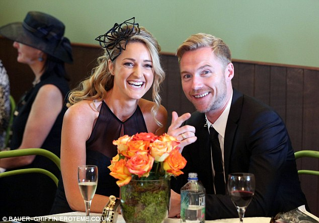 Say cheese! The fair haired duo smiled widely as they turned out to the Flemington race track dressed in their finest gear