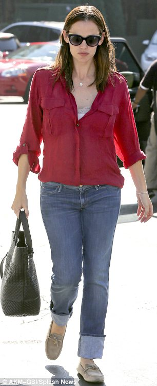 Mum on the run: On Saturday Jennifer looked casual in a red blouse and boyfriend jeans as she stepped out in Brentwood