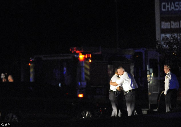 Tragic: Officers mourn after two colleagues were killed in the tragic crash