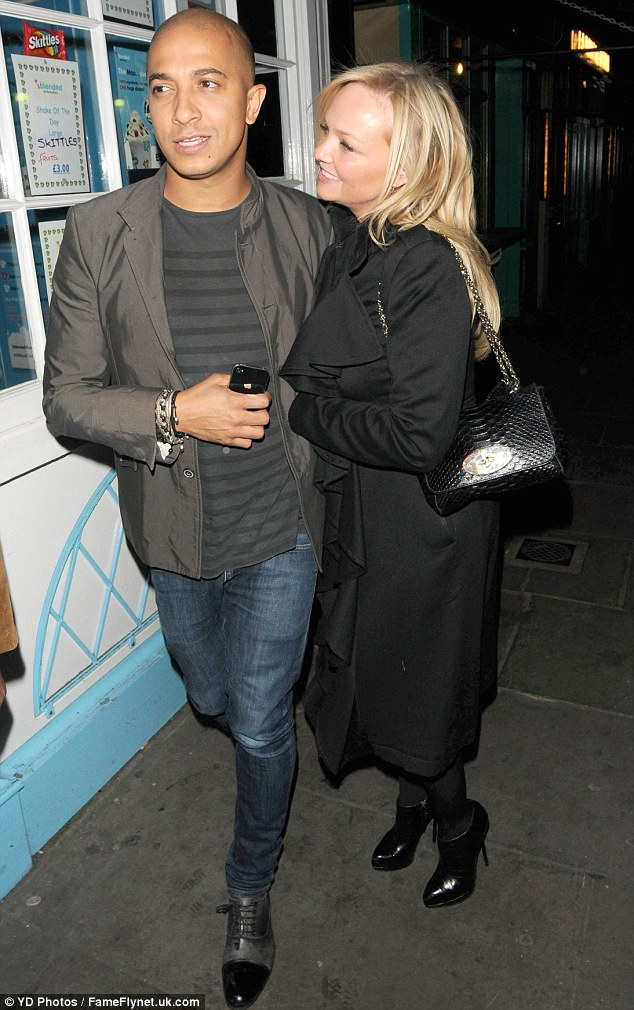 The look of love: The Spice Girls singer looked positively smitten as she cuddled up to her man
