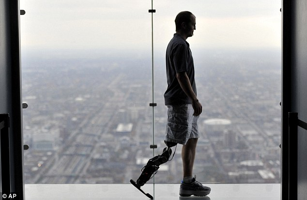 Zac, who lost his leg following a motorcycle accident, made it to the top of the tower in under an hour