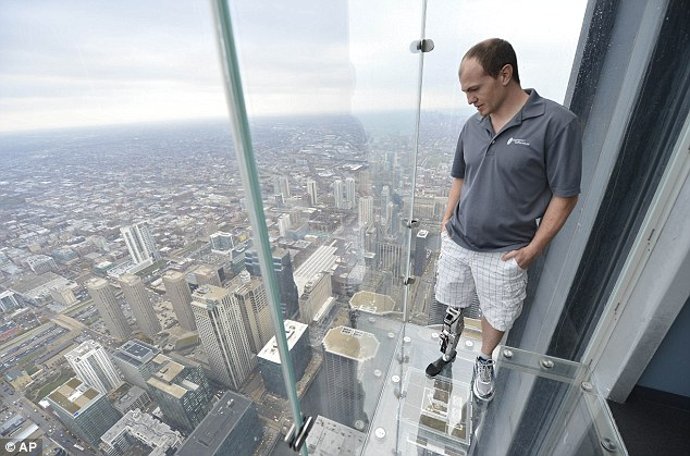 On top of the world: Zac Vawter looks down from the Ledge at the Willis Tower, where he completed the climb on the bionic leg