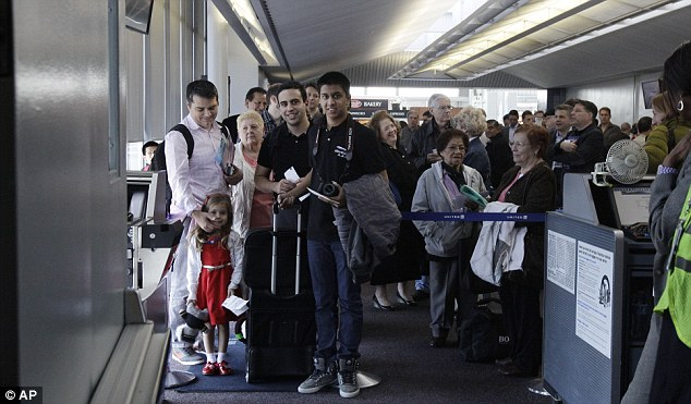 Excitement: Passengers wait to board a 787 Dreamliner aircraft after it landed at Chicago O'Hare