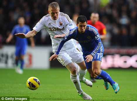 Roll with the punches: Garry Monk has progressed through the leagues with Swansea